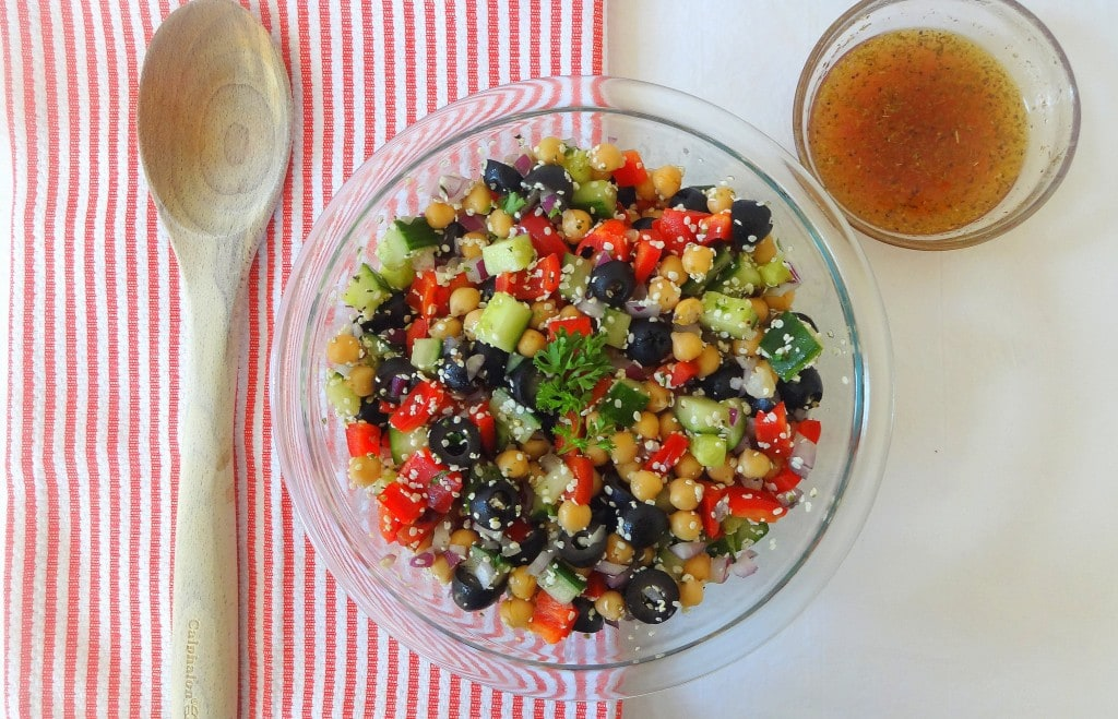 Simple Greek Veggie Salad with Easy Homemade Dressing. Perfectly crunchy, full of flavor, color, protein and nutrients. From theglowingfridge.com