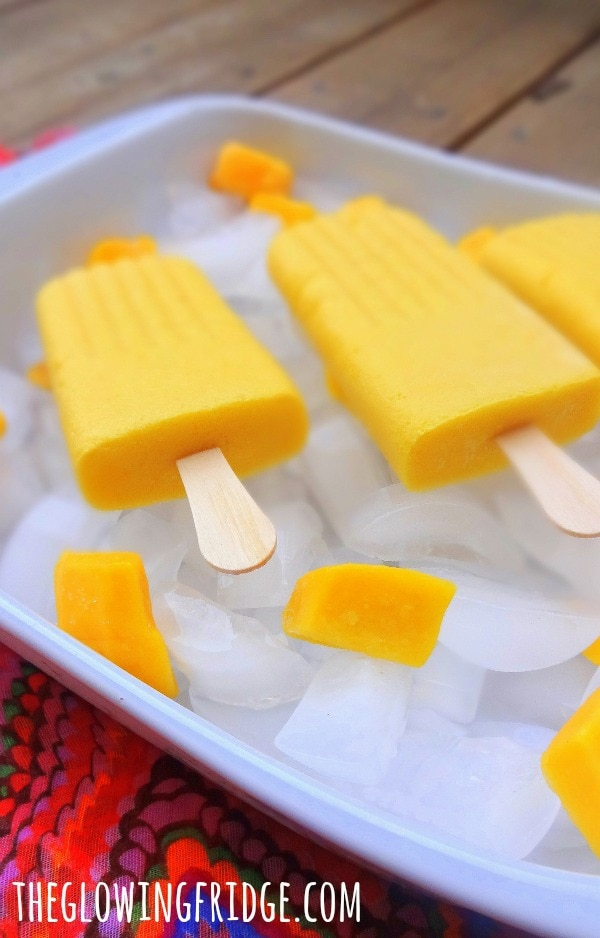 Mango Ginger Popsicles - Refreshing and only 3 ingredients! A healthy summer treat - From The Glowing Fridge