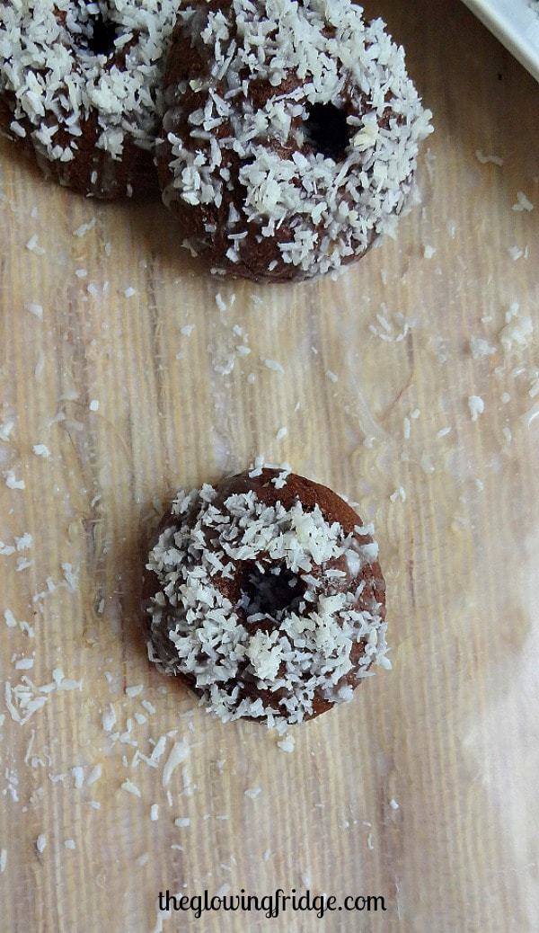 Fudgy Coconut Glazed Mini Donuts - vegan and no donut pan required! These bite-sized donuts are easy to make and fun to share. From The Glowing Fridge