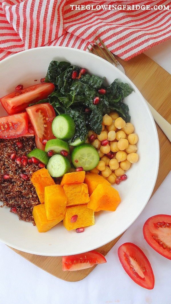 || Autumn Glow Bowl || A cleansing, filling, vegan, Glow Bowl to transition into the new season with warming, comforting ingredients. A super clean, delicious recipe with butternut squash, quinoa, kale, chickpeas, tomatoes and a sprinkle of pomegranate seeds! From The Glowing Fridge.