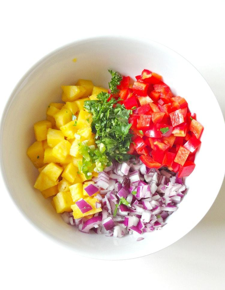 Raw Vegan Pineapple Salsa. FRESH, crunchy, spicy and sweet. This healthy salsa with a tropical twist is essential for summer. From The Glowing Fridge.