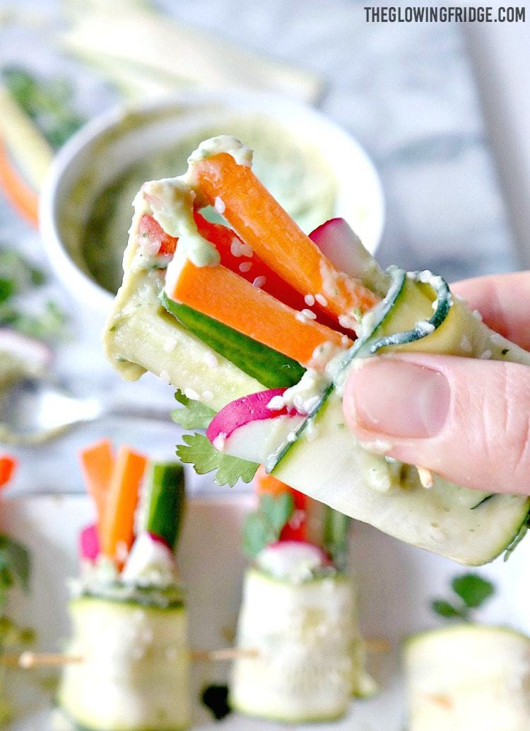 Vegan Veggie Rolls with Avocado Hummus - makes the perfect appetizer or starter that's healthy and fun! Fresh, crunchy veggies with a light and creamy avocado hummus. Flavorful, unique and something everyone can enjoy! From The Glowing Fridge.