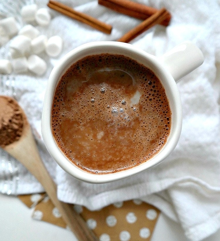 Get toasty with this Homemade Vegan Hot Chocolate. Luscious, comforting, and so easy to make. Using a cacao spice blend, you'll never want store-bought hot cocoa again after drinking this healthier (way more delicious) alternative! From The Glowing Fridge. #vegan #dairyfree #hotchocolate
