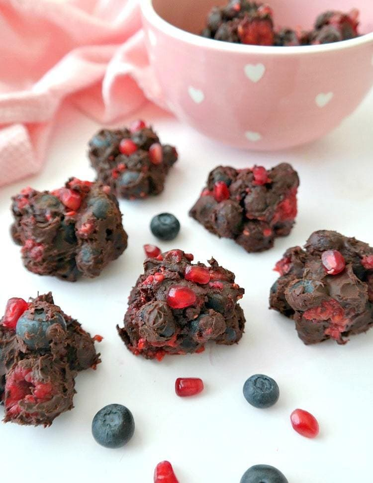 VEGAN. Mixed Berry Chocolate Clusters. Melted vegan chocolate stirred into fresh mixed berries. The BEST and EASIEST Valentine's Day Vegan Dessert. From The Glowing Fridge. #vegan #valentinesday #dessert #chocolate
