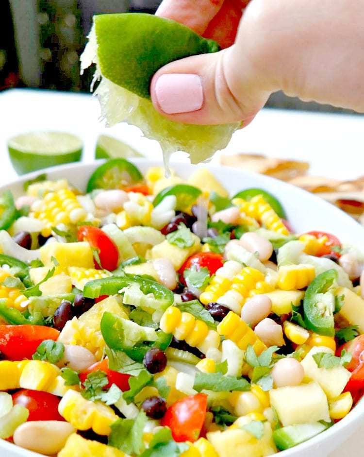 Summer Corn, Pineapple and Black Bean Salsa. Vegan & Gluten Free. Super fresh, chunky, healthy and crunchy. SO simple to make. and very versatile, can be eaten many different ways! From The Glowing Fridge #salsa #summer #addicting