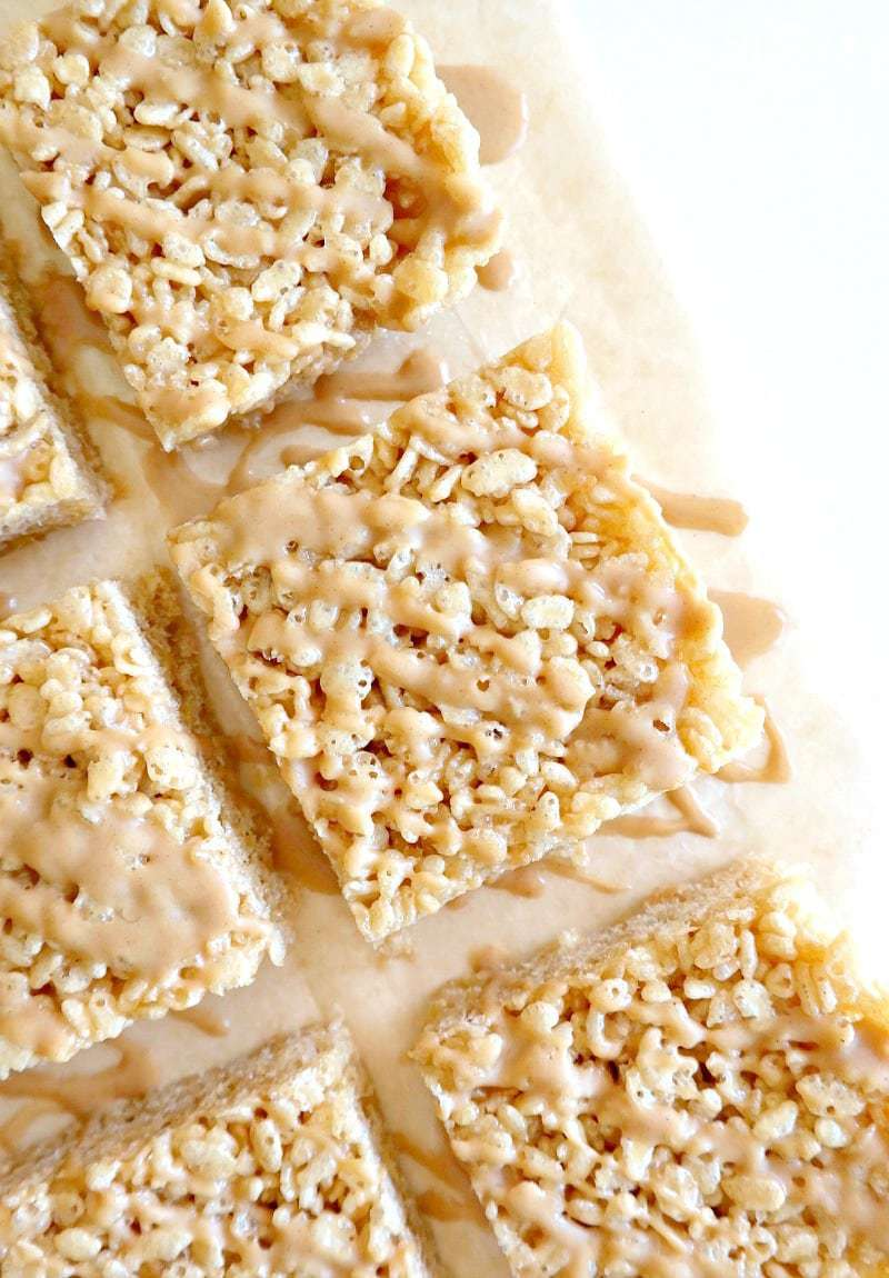 Peanut Butter Caramel Rice Krispies. Vegan, Gluten Free, Oil Free and naturally sweetened. No marshmallows needed for these sticky squares of heaven as we use natural ingredients for a healthier krispie treat! #vegan #glutenfree #rice #krispie #treat