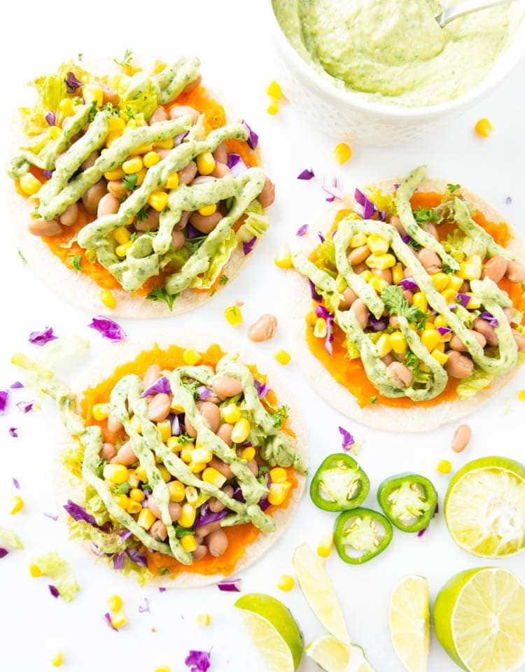 Roasted Sweet Potato Mash Tostadas. Vegan, Oil Free, Gluten Free. Clean, super simple and lots of fun to make! With a pinto bean & sweet corn mixture, all the toppings and a Spicy Magic Green Sauce. Healthy, satisfying and vibrant! #vegan #tostadas