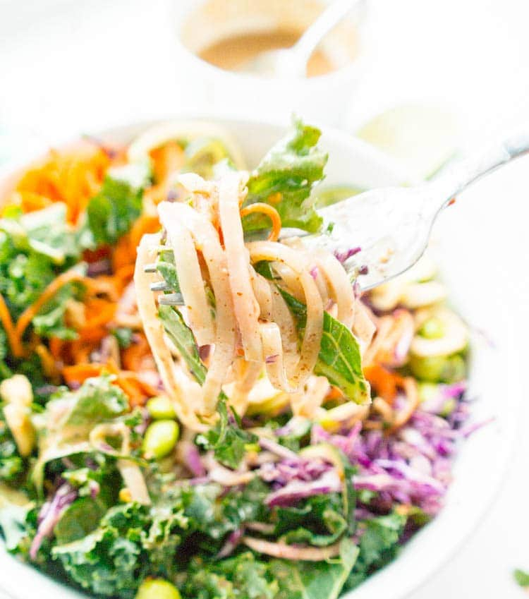 Vegan, Gluten Free. Crunchy Thai Noodle Salad and Oil-Free Spicy Almond Butter Dressing. With kale, raw carrot noodles, zoodles, cabbage, edamame and optional brown rice noodles, with the most decadently creamy dressing!