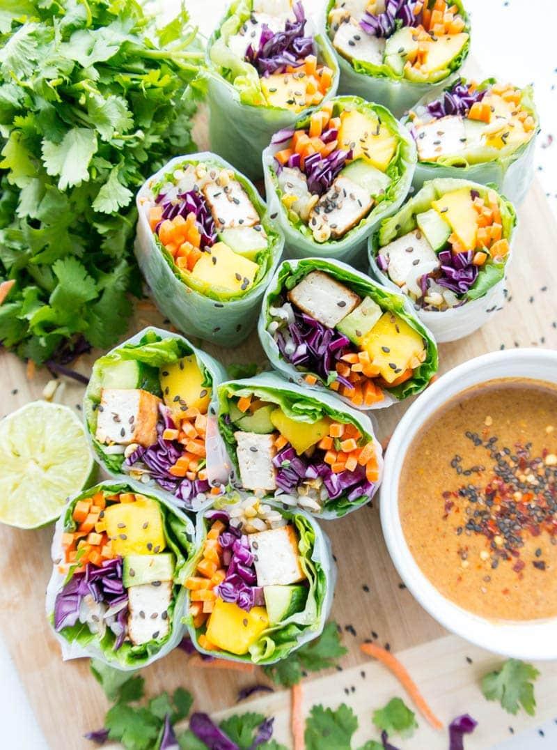 Tofu Veggie Summer Rolls with Spicy Almond Butter Sauce. Vegan, Gluten Free, Plant Based. Fresh, light & super healthy with crispy tofu, crunchy veggies, juicy mango & tangy, spicy almond butter dipping sauce! #vegan #summer #rolls