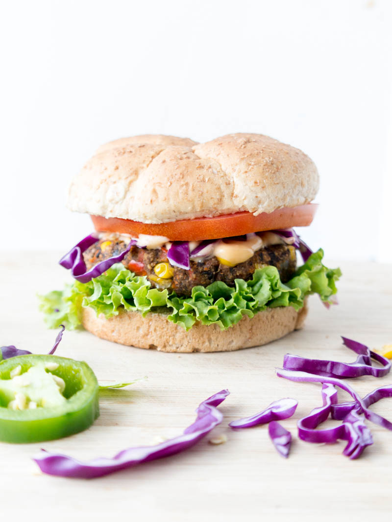 Vegan & Gluten Free 'Spicy Black Bean Burgers'. Thick & firm, they hold together perfectly! Scrumptiously tasty, easy & healthy black bean veggie burgers. Reliable for summer cookouts and parties, to impress even the most skeptical of guests! #vegan #blackbean #burger
