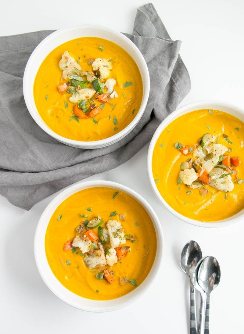 SPICY VEGAN PUMPKIN SOUP, with hidden veggies! Luxuriously smooth and velvety rich. Gluten Free and great for meal prepping. #vegan #soup #pumpkin #spicy