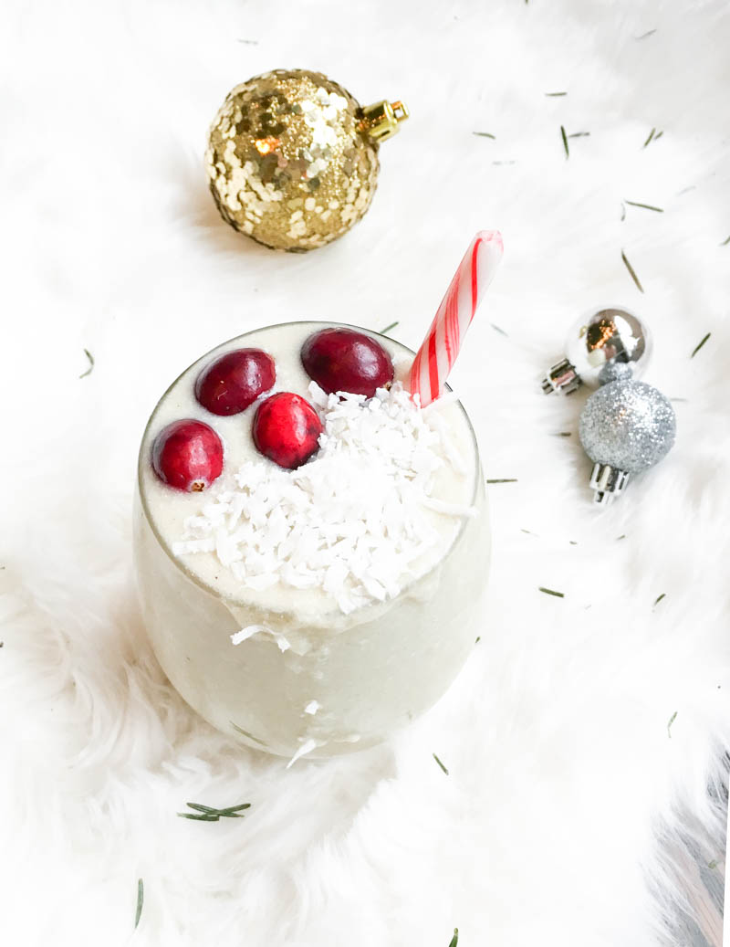 Vegan 'Holiday White Peppermint Smoothie'. Creamy and frosty-like with hints of peppermint flavor, this healthy breakfast smoothie is full of healthy fats and protein to keep you going this holiday season! #vegan #holiday #peppermint #smoothie