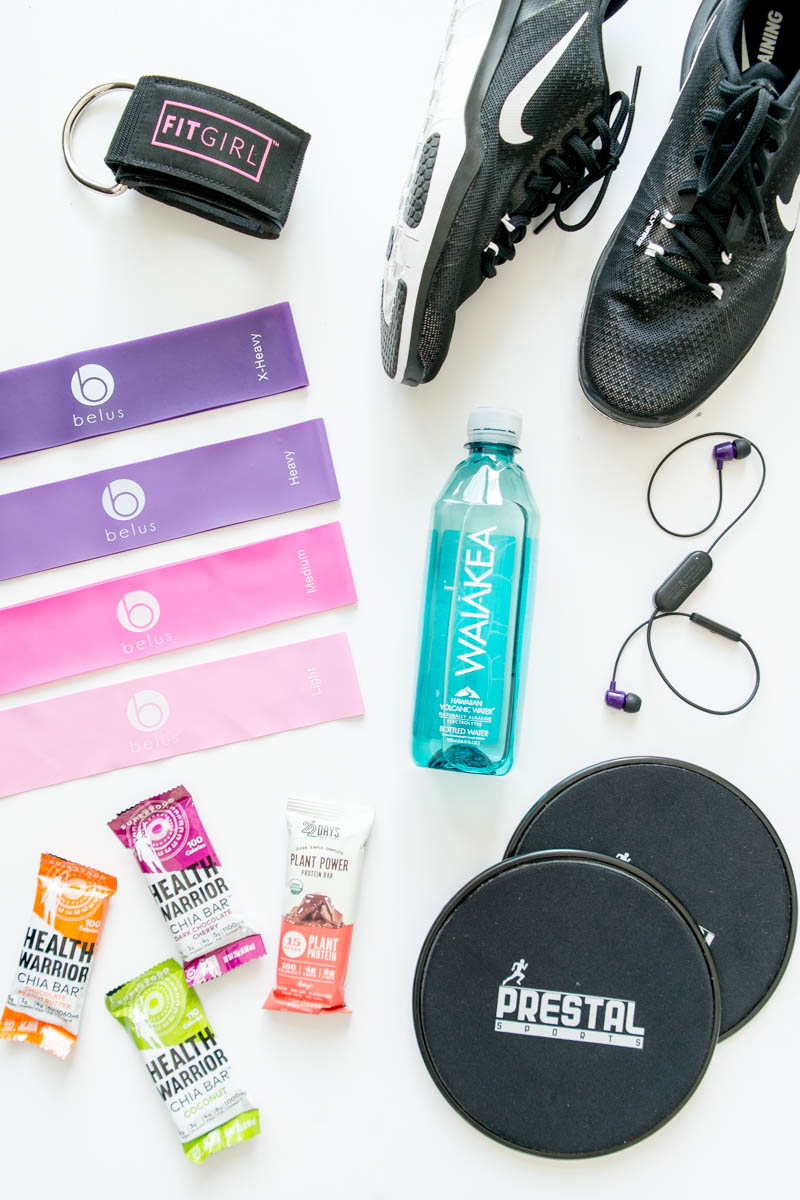A Peek Inside My Gym Bag. My gym essentials including booty bands, sliders, training shoes, alkaline water, vegan protein snack bars, best gym duffle bag and more!