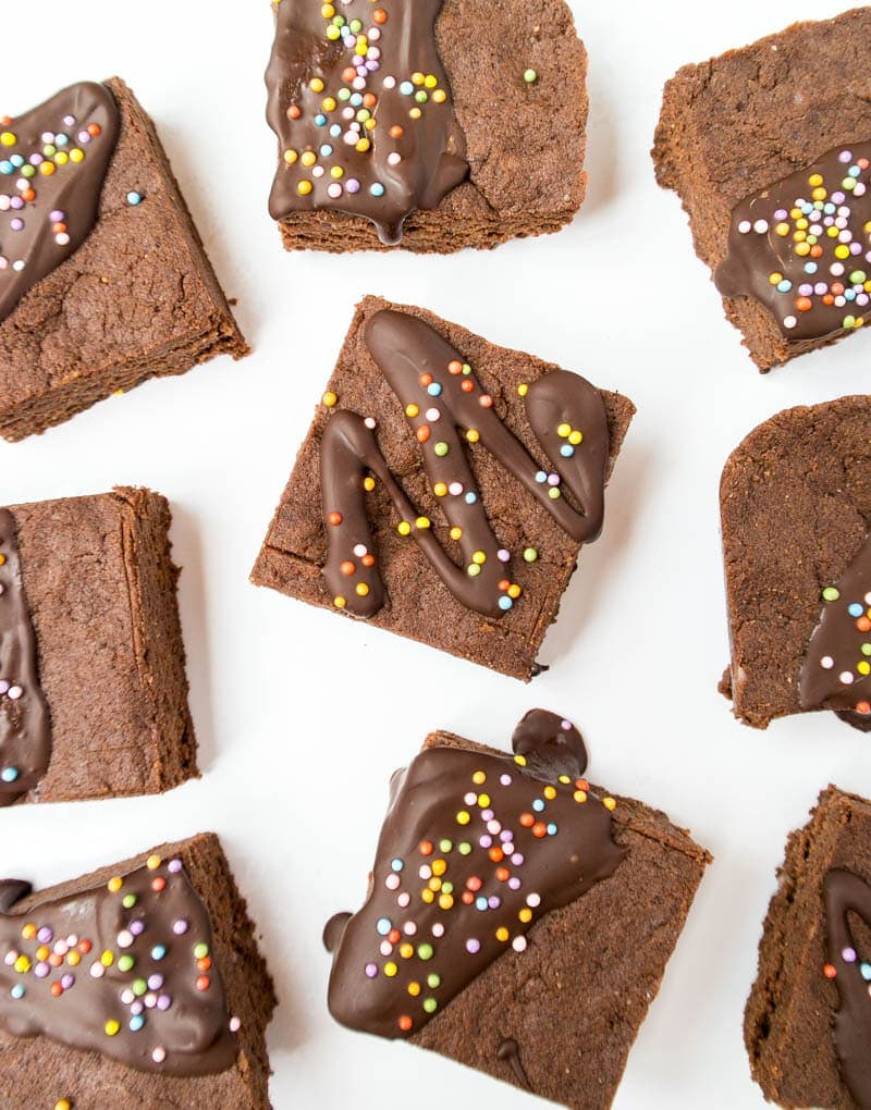 Quick No-Bake Chocolate Covered Protein Bars. A vegan, gluten free, high in protein homemade snack that tastes like a chewy fudge brownie! Comes together quickly and couldn't be easier! #vegan #protein #fudge #bars #chocolate