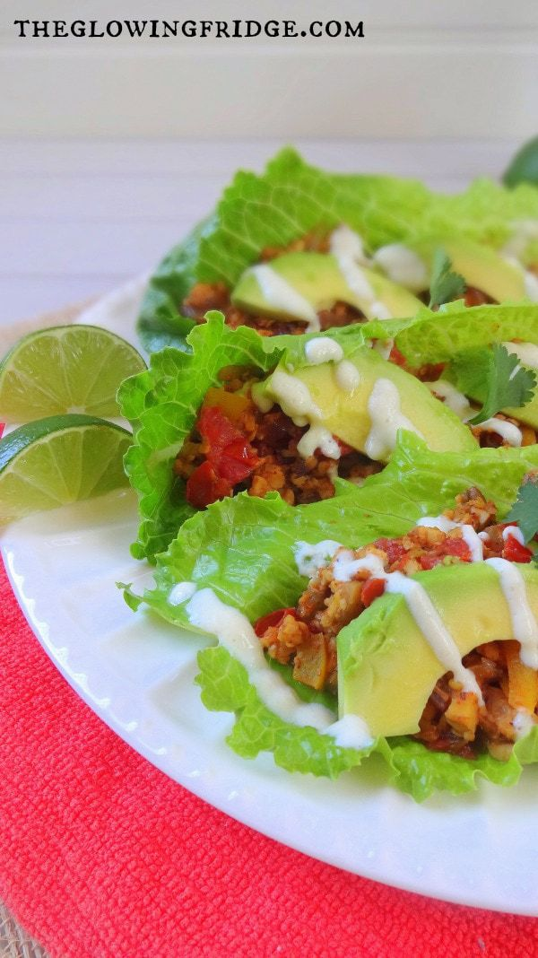 Delicious Tempeh Taco Boats that everyone will love! You can use lettuce leaves or tortillas, along with a homemade vegan sour cream recipe! - From The Glowing Fridge