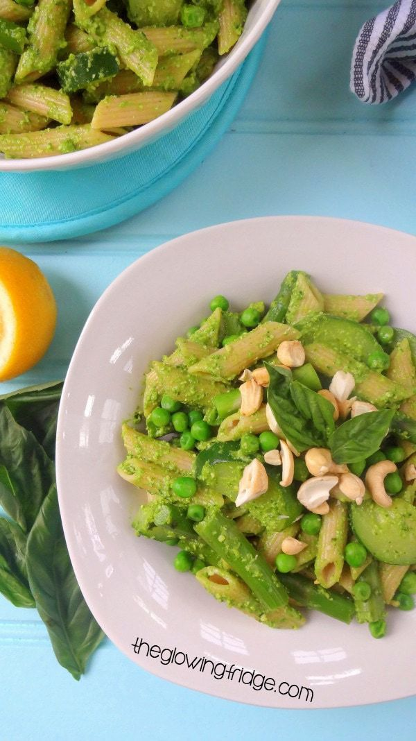One-Pot Pesto Asparagus Pasta with Zucchini and Peas! Vegan and can be made GF. Vibrantly colored green, creamy (and totally lickable) pesto. This dish is healthy, comforting, delectable and made in one pot to make your life easier!