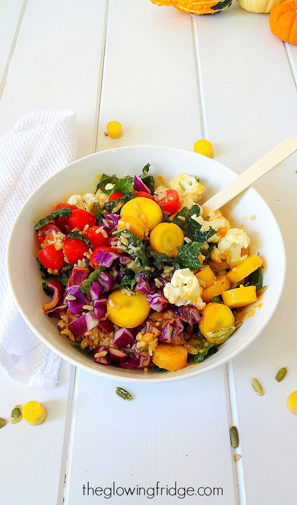 The Kale Glow Bowl with Pumpkin Dressing - vegan and gluten free - super nourishing, filling and festive with kale, cauliflower, cabbage, grape tomatoes, carrots, brown rice and pumpkin seeds. Plus a creamy, tangy pumpkin vinaigrette! From The Glowing Fridge