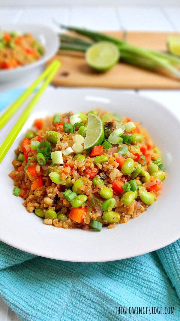 "Healthy Cauliflower ""Fried"" Rice Bowl - vegan + gf - quick, nourishing, delicious and a definite crowd-pleaser! This nutritious vegetable bowl has high-quality plant protein from the edamame and can easily replace your favorite ""fried"" rice take-out. From The Glowing Fridge."