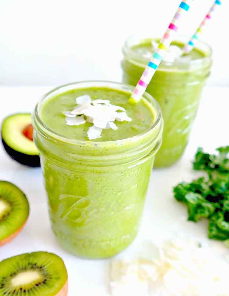 Creamy Kale Coconut Smoothie. VEGAN. Balancing, nutrient-dense, packed with beauty minerals and super creamy from avocado, this is a brain-boosting green monster smoothie with tropical vibes that you will LOVE. From The Glowing Fridge.