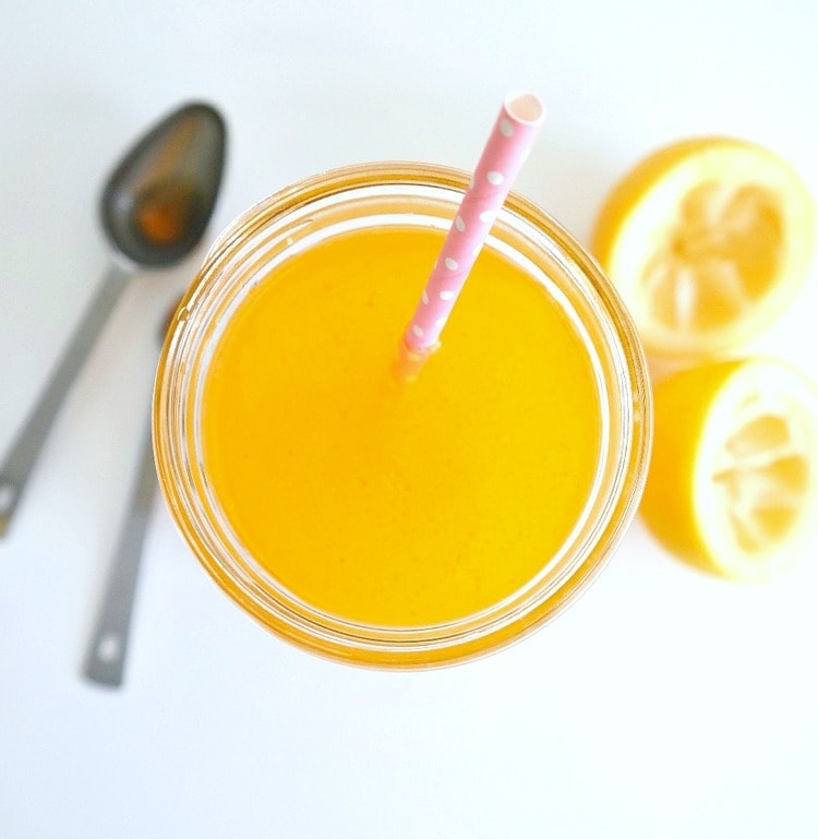Turmeric Glow Lemonade. VEGAN. Healthy lemonade with a vibrant twist of immune-boosting and glowifying turmeric, a hint of spicy cayenne and a touch of sweet maple syrup. A refreshing, energizing, thirst-quenching summer sip! From The Glowing Fridge.