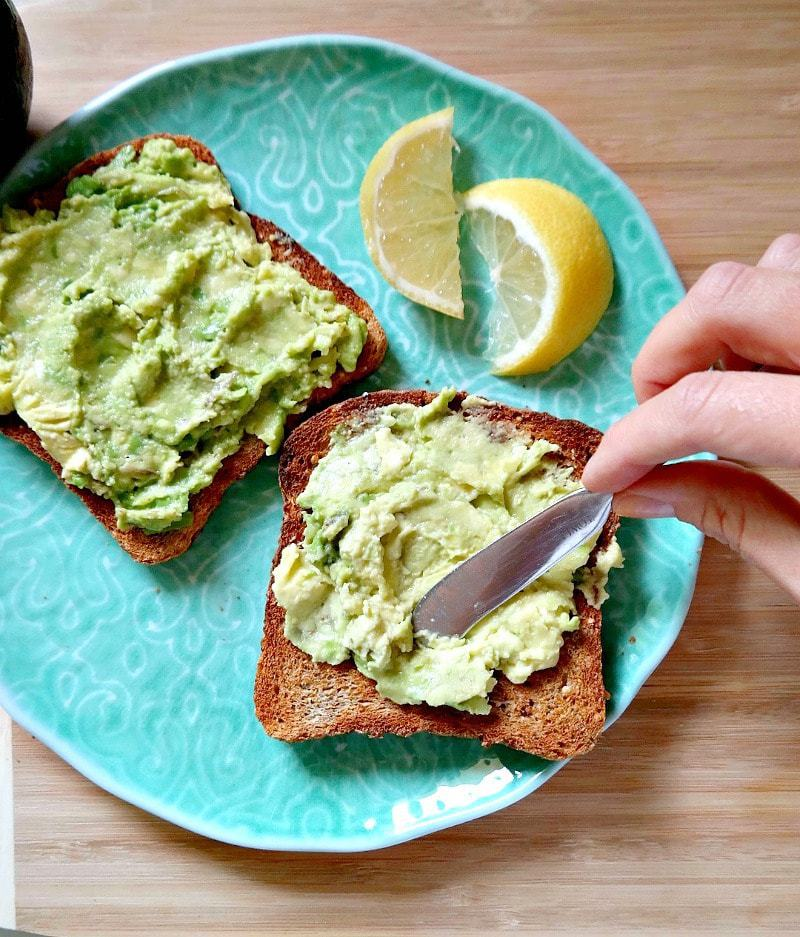 The easiest, dreamiest, toastiest 'Avocado Toast'. For a super quick, less than 5 minutes healthy vegan breakfast or snack. So nourishing and delicious with lots of topping/combination ideas! Keep it simple or make it fancy. #vegan #avocado #toast