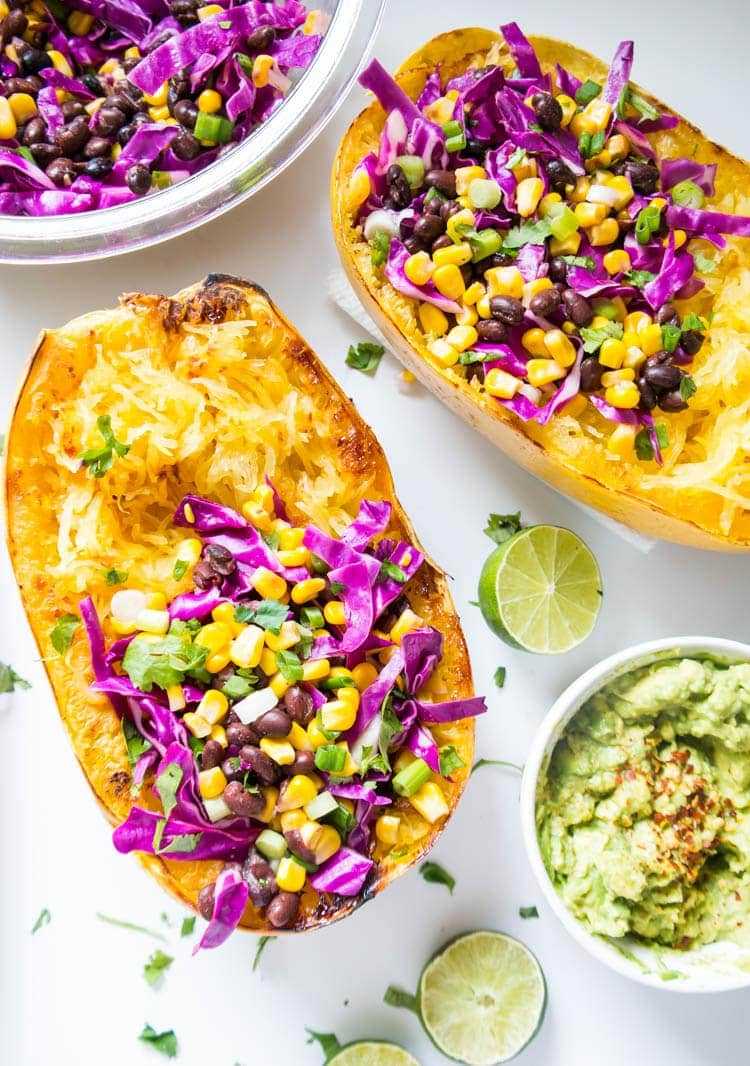 Spaghetti Squash Black Bean Bowls. Get your chipotle bowl fix with these crazy healthy (and delish!) bowls that are vegan, gluten free and oil free. A must-try!!! #spaghetti #squash #vegan #chipotle #bowls