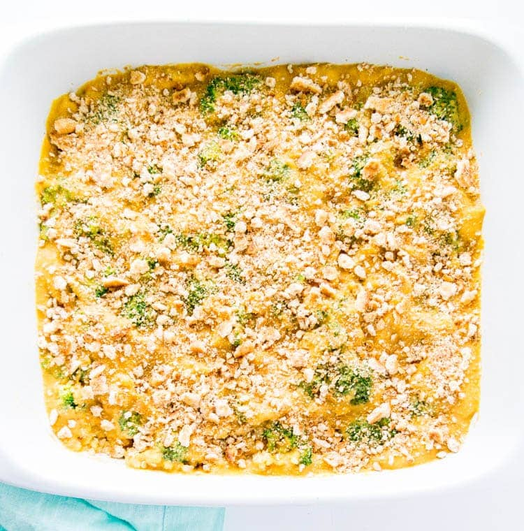 Cheesy Vegan Broccoli Brown Rice Bake. Oil Free, Gluten Free, Nut Free, Dairy Free. This is plant based cold-weather comfort food, with literally the BEST savory cheese sauce, that's also high in plant protein. #vegan #cheesy #casserole