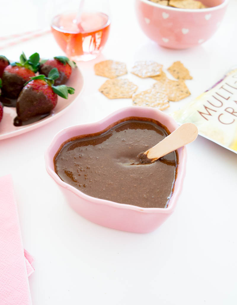 Easy Vegan Nutella. A healthier, dreamy, creamy, homemade hazelnut chocolate spread. No added oils! Spread on toast, use as a dip for fruit or grab a spoon! #vegan #nutella