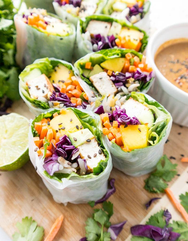 Tofu Veggie Summer Rolls with Spicy Almond Butter Sauce. Vegan, Gluten Free, Plant Based. Fresh, light & super healthy with crispy tofu, crunchy veggies, juicy mango & tangy, spicy almond butter dipping sauce! #vegan #summer #rolls