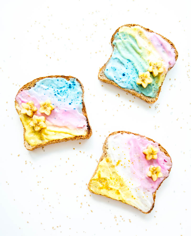 Unicorn Toast. Vegan with all natural food coloring options, from actual food! Swirled with coconut milk yogurt or dairy free cream cheese. Creative & fun breakfast or snack! #unicorn #toast #vegan