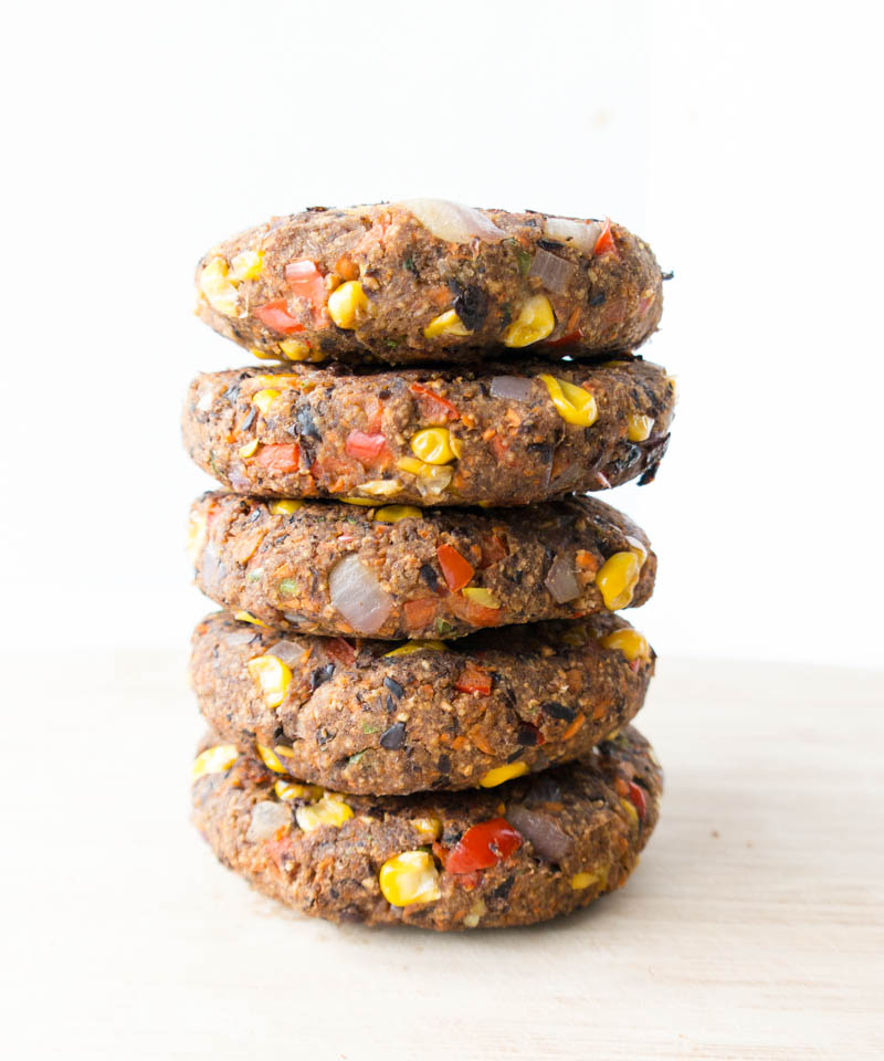 Vegan & Gluten Free 'Spicy Black Bean Burgers'. Thick & firm, they actually hold together. No crumbling! Scrumptiously tasty, easy & healthy black bean veggie burgers. Reliable for summer cookouts and parties, to impress even the most skeptical of guests. #vegan #blackbean #burger