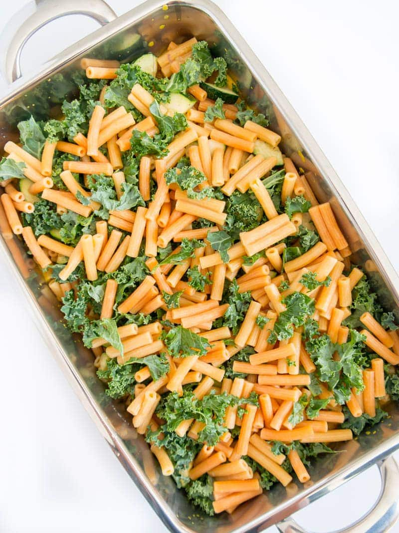 "Pumpkin and Kale Pasta Bake. Vegan and gluten free. Made with protein rich lentil pasta, in the creamiest savory Pumpkin Sauce, with veggies and kale baked in. Topped with grain-free cashew ""breadcrumbs"" for a crusty topping! #vegan #pumpkin #pasta #bake"
