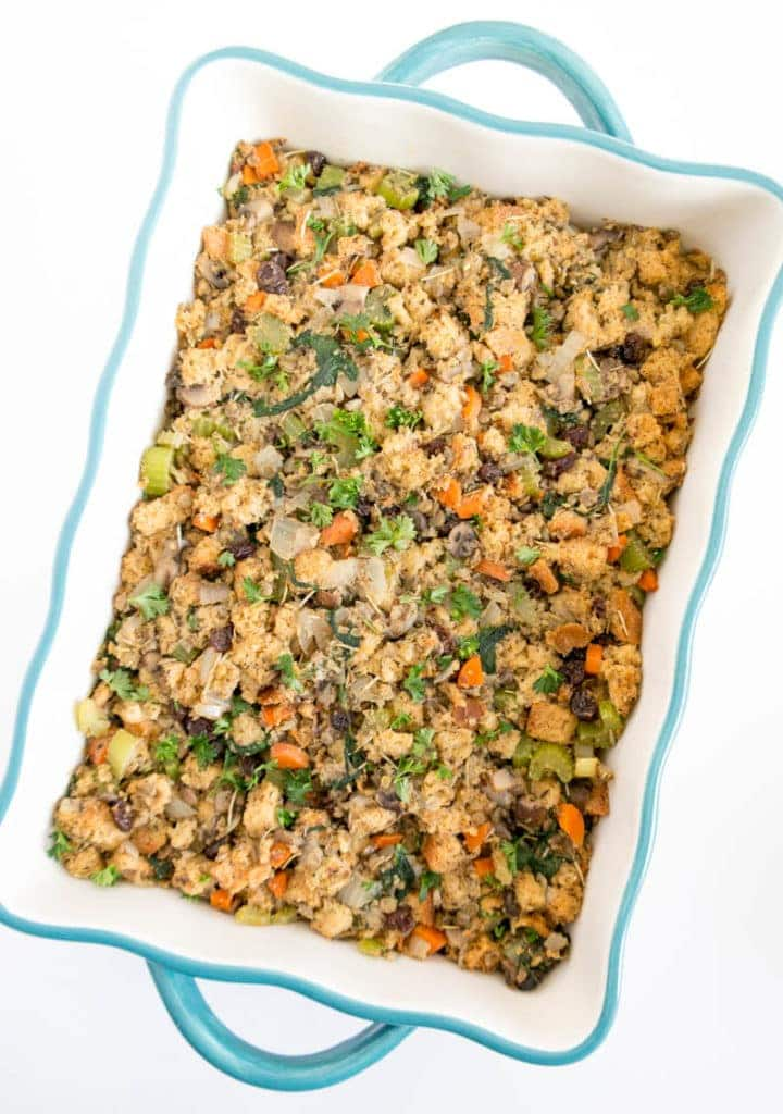 Veggie Herb Vegan Stuffing. Perfectly flavored and savory sweet for Thanksgiving! Made with protein-packed lentils, carrots, celery, mushrooms and raisins for a wholesome #vegan Stuffing! #thanksgiving #stuffing