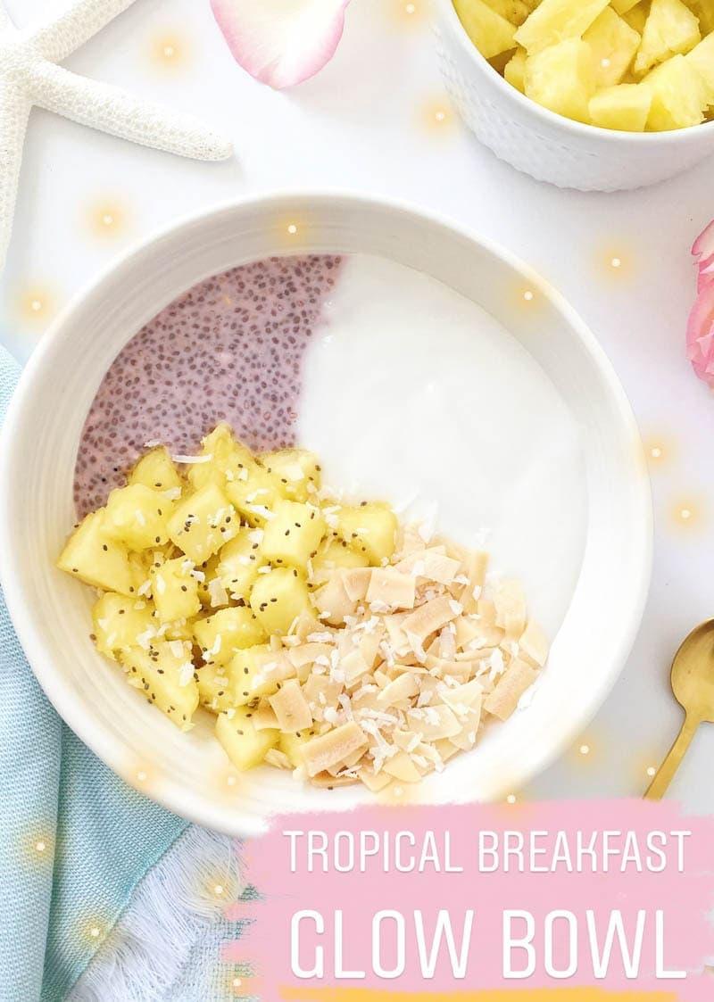 Vegan and Dairy Free 'Tropical Breakfast Glow Bowl' with coconut yogurt, chia pudding, juicy pineapple and toasted coconut. YUMM. #vegan #breakfastbowl #coconutyogurt #bowl