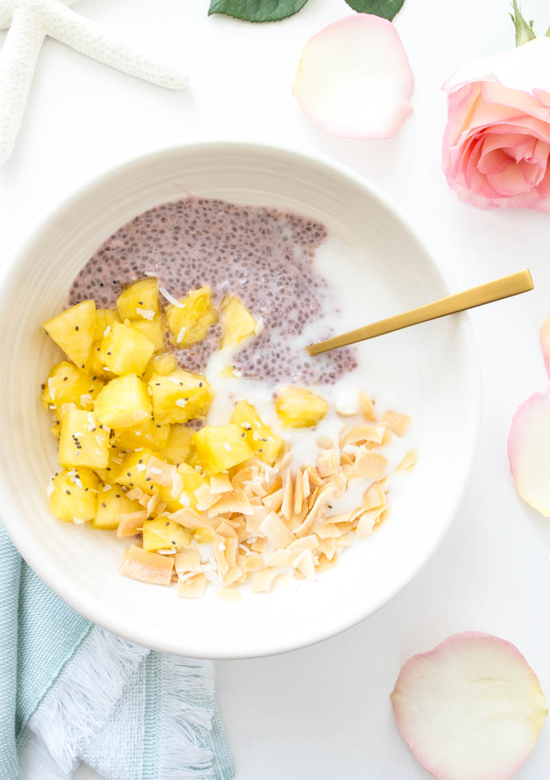 Tropical Breakfast Glow Bowl with coconut yogurt, fresh pineapple and chia pudding. Vegan and Gluten Free. Packed with healthy fats and fiber to start the day off right as a healthy, fresh breakfast or easy snack. #dairyfree #vegan #yogurtbowl