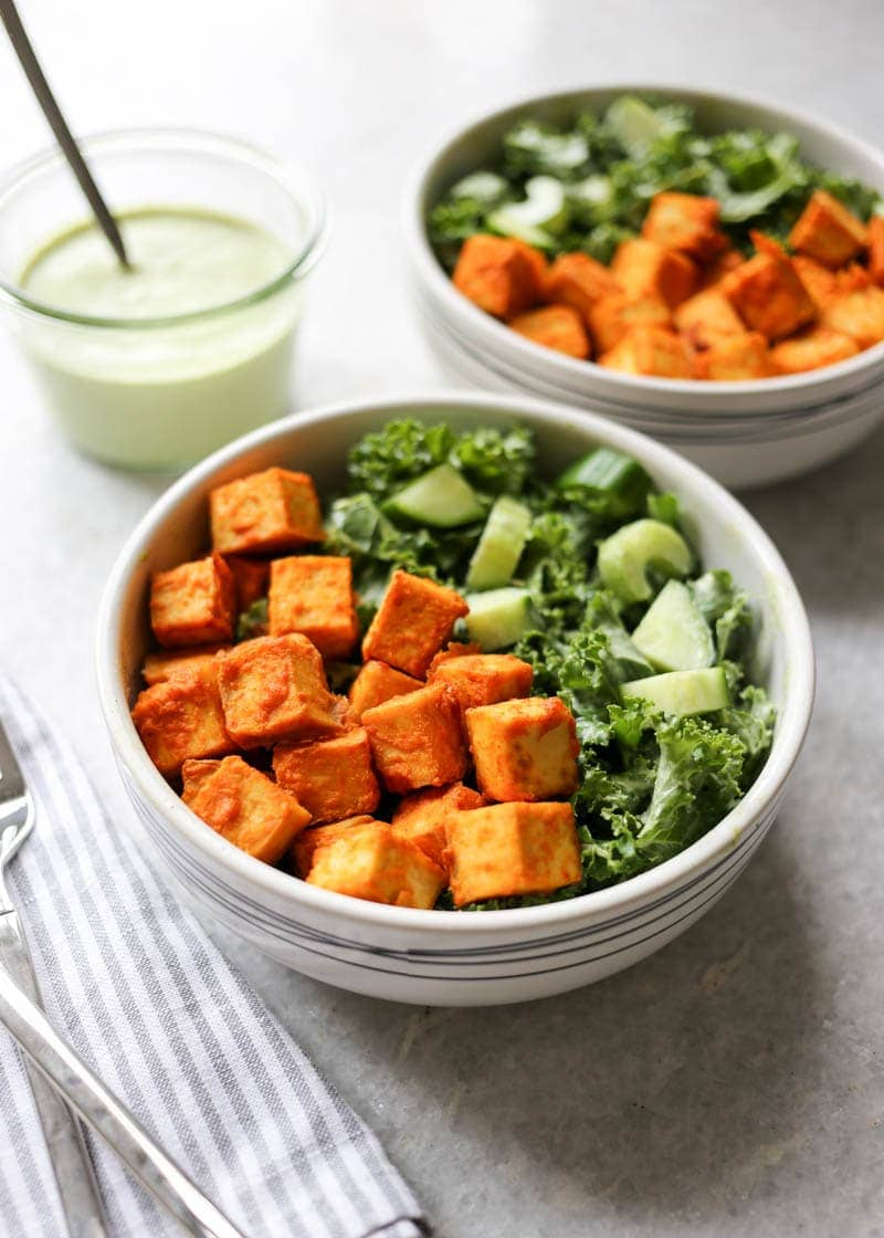 Crispy Buffalo Tofu and Kale Salad with Vegan Ranch. The most scrumptious baked buffalo tofu with the creamiest, dreamiest homemade vegan ranch dressing! #vegan #buffalo #tofu #ranch #dressing #kale