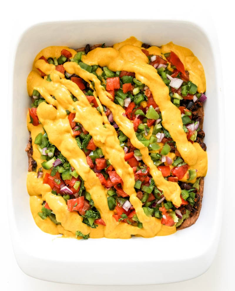Vegan Mexican Seven-Layer Dip. It's FRESH, creamy and classically delicious, all in one crowd-pleasing bite. It makes for the best snacking, with corn tortilla chips of course. #vegan #mexican #layer #dip #appetizer