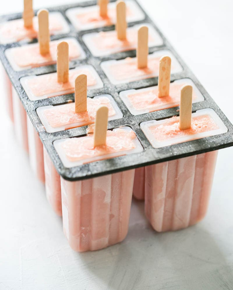 Watermelon Peach Popsicles. Dairy-free and vegan. Made with hydrating watermelon, juicy peaches and coconut cream for a dreamy summer popsicle! #vegan #popsicles #watermelon #peach #coconut
