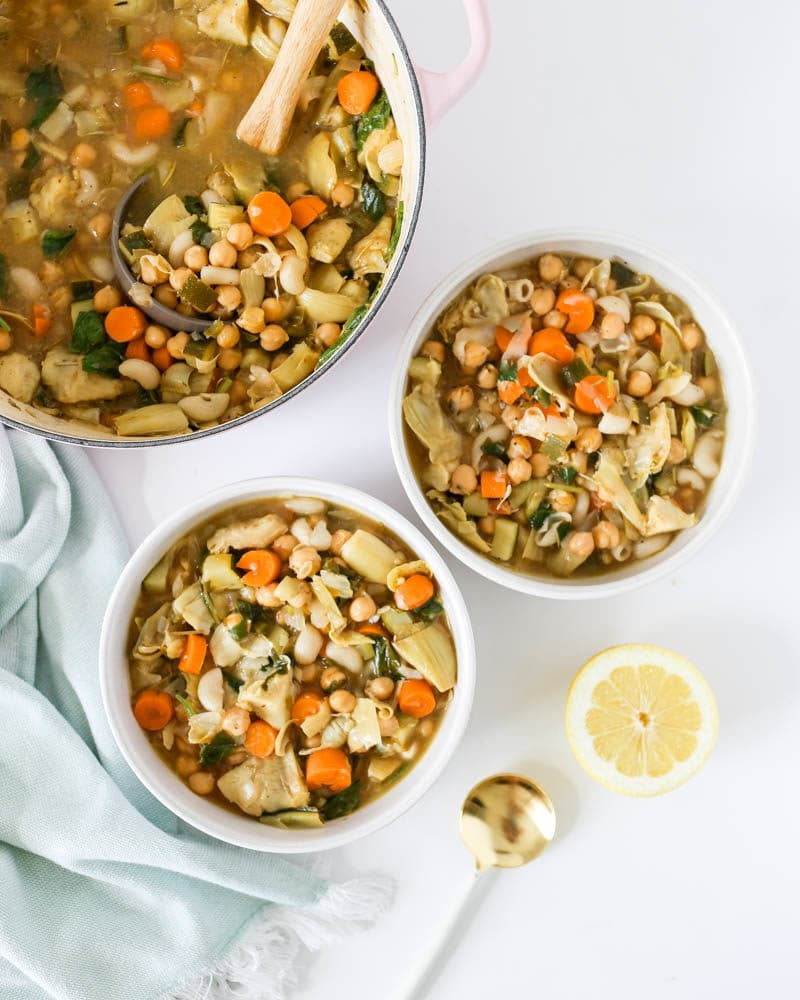 Lemony Chickpea Vegan Stew. With rosemary, lemon, veggies, chickpeas and gluten free pasta. Warming, satisfying and heart-healthy! A one-pot vegan stew that's light and simple. #onepot #vegan #stew