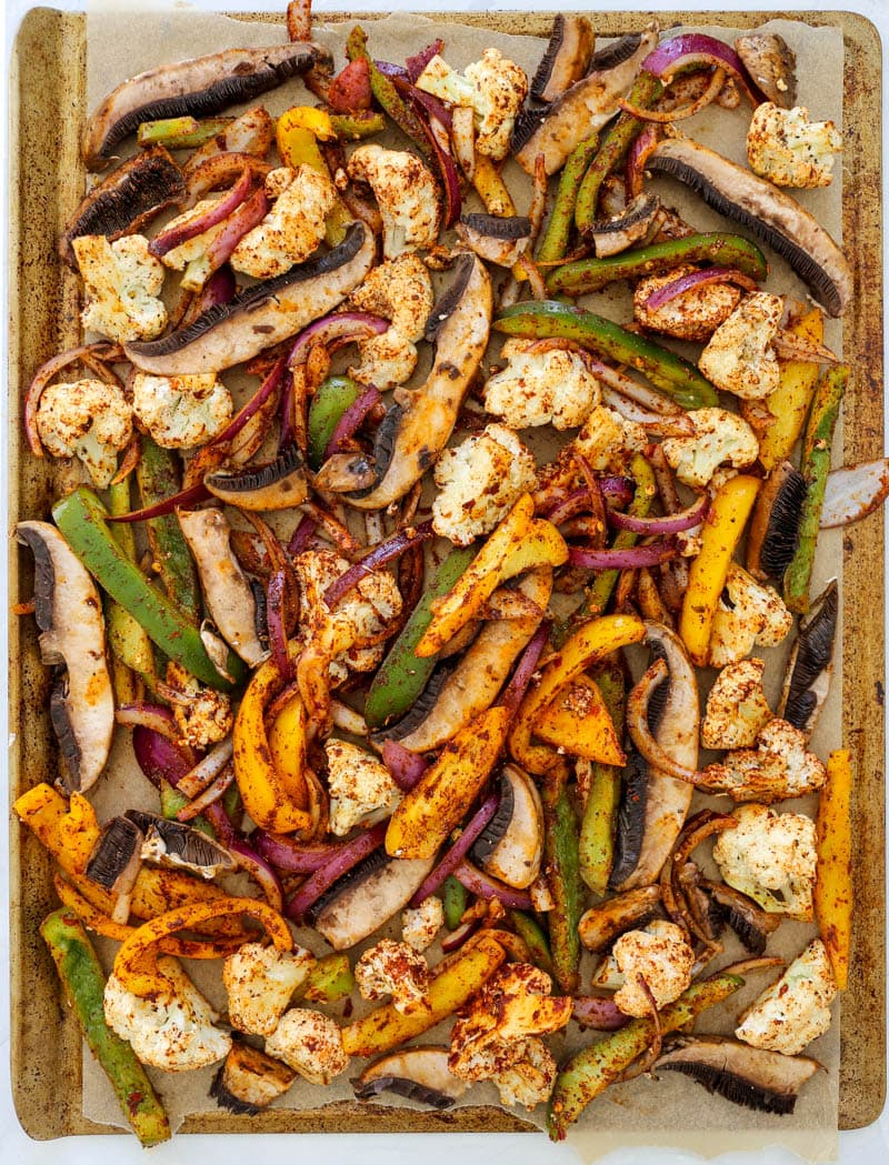 Sheet Pan Fajitas with White Queso (Vegan). The easiest veggie-packed dinner ever! Ready in 30 minutes, alongside the most delectable vegan white queso dip. #sheetpan #fajitas #vegan #queso #whitequeso