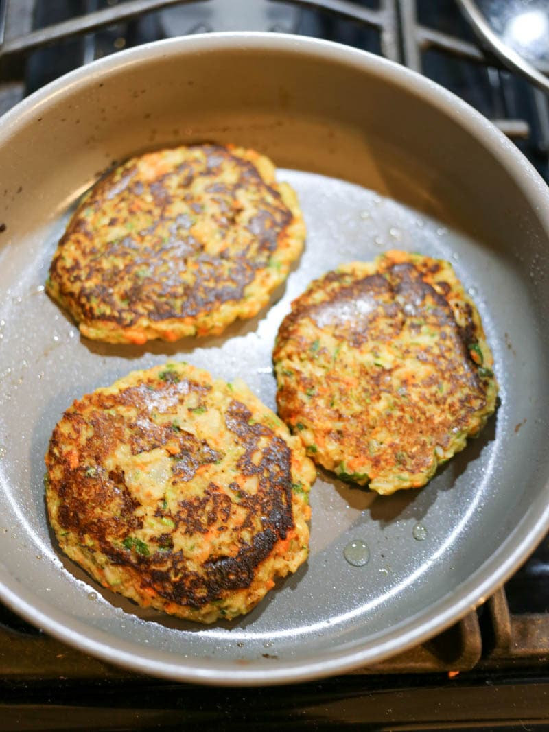 Vegan Veggie Fritters that are so simple and also gluten free! Easy, packed full of veggies and fiber. Crispy on the outside. Similar to a potato pancake! #vegan #fritters